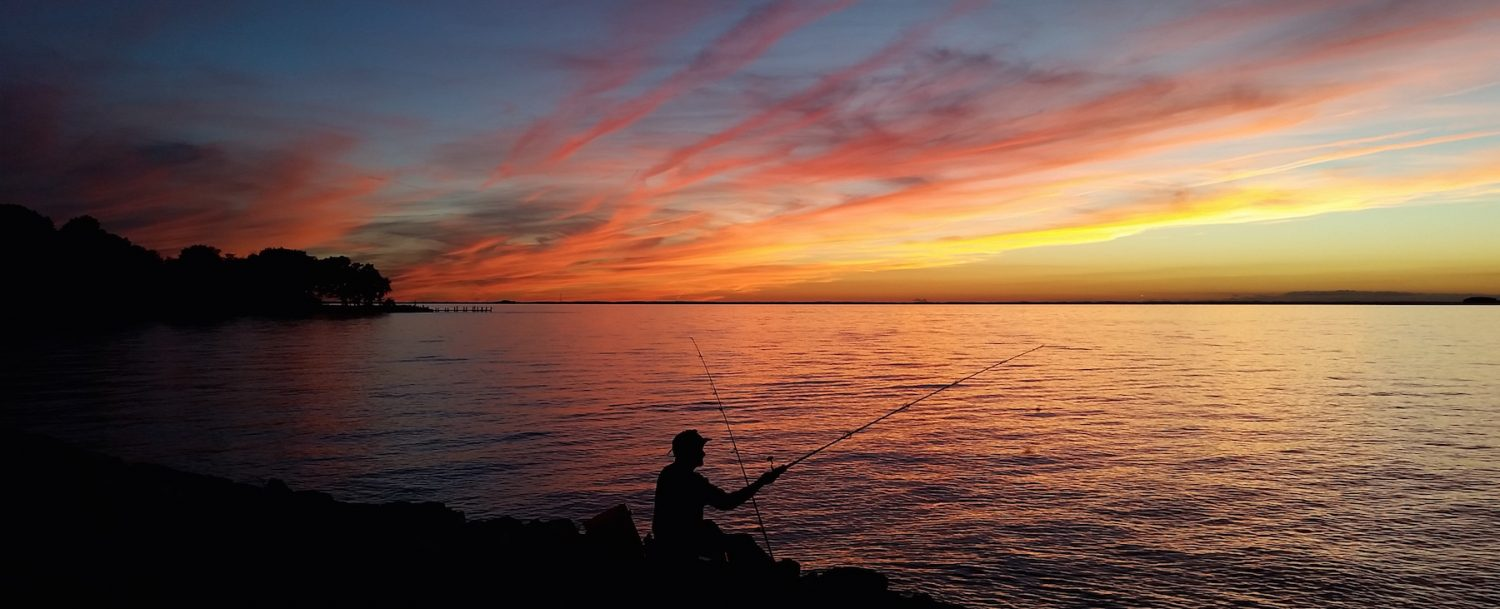Man fishing on the bayside in St. Michaels, Maryland.